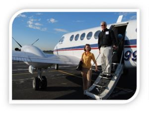 woman and man exiting a chartered plane