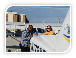 Instructor and student standing by plane
